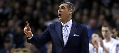 Villanova head coach Jay Wright gestures from the sideline during the first half of an NCAA men's college basketball tournament regional final against Texas Tech, Sunday, March 25, 2018, in Boston. (AP Photo/Charles Krupa)