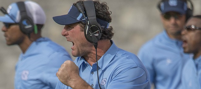 FILE — Former North Carolina linebackers coach Mike Ekeler yells to players during the first half of an NCAA college football game, Saturday, Oct. 21, 2017, at Lane Stadium in Blacksburg, Va. Les Miles hired Ekeler on Dec. 14, 2018, to be Kansas football's special teams coordinator. (AP Photo/Don Petersen)