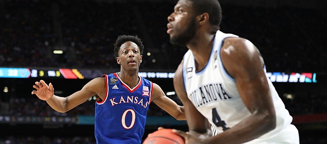 Kansas guard Marcus Garrett (0) is late getting to Villanova forward Eric Paschall (4) as he lines up a three during the first half, Saturday, March 31, 2018 at the Alamodome in San Antonio, Texas.
