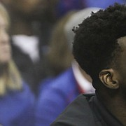Injured center Udoka Azubuike  watches from the bench during the second half on Saturday, Dec. 8, 2018 at Sprint Center.