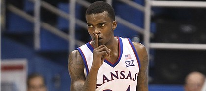 Kansas guard Lagerald Vick (24) shushes a Villanova player after hitting a three during the second half, Saturday, Dec. 15, 2018 at Allen Fieldhouse.