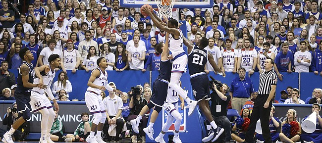 Kansas guard Lagerald Vick (24) grabs a rebound with seconds remaining in the game, Saturday, Dec. 15, 2018 at Allen Fieldhouse.