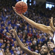 Kansas forward Dedric Lawson (1) extends for a rebound against Villanova forward Eric Paschall (4) and Villanova forward Jermaine Samuels (23) during the first half, Saturday, Dec. 15, 2018 at Allen Fieldhouse.