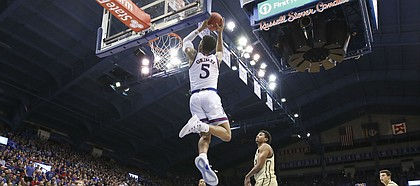 Kansas guard Quentin Grimes (5) gets up for a lob jame against Wofford during the second half on Tuesday, Dec. 4, 2018 at Allen Fieldhouse.