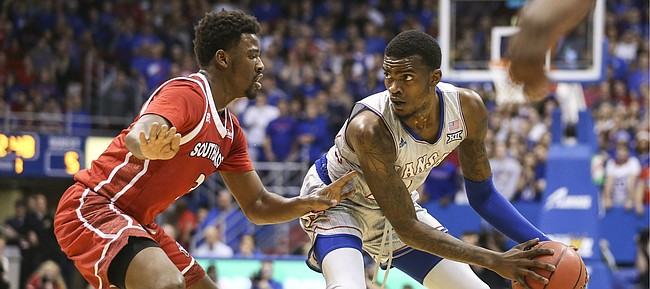 Kansas guard Lagerald Vick (24) looks to make a mov against South Dakota guard Triston Simpson (3) during the first half, Tuesday, Dec. 18, 2018 at Allen Fieldhouse.