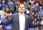 Newly-hired Kansas football coach Les Miles greets the Allen Fieldhouse crowd during halftime of the Jayhawks' game against Stanford on Dec. 1, 2018.
