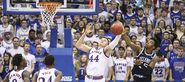 Kansas forward Mitch Lightfoot (44) battles for a rebound with Villanova forward Saddiq Bey (15) during the second half, Saturday, Dec. 15, 2018 at Allen Fieldhouse.