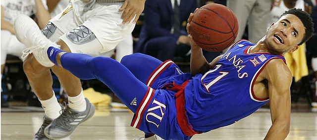 Kansas guard Devon Dotson (11) loses the ball in front of Arizona State guard Rob Edwards during the first half of an NCAA college basketball game Saturday, Dec. 22, 2018, in Tempe, Ariz. (AP Photo/Rick Scuteri)