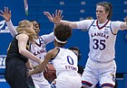 Kansas' Christalah Lyons (0), Austin Richardson (14), and Bailey Helgren (35) trap Vermont's Hanna Crymble (10) for a steal in the first quarter on Sunday, Dec. 30, 2018 at Allen Fieldhouse.