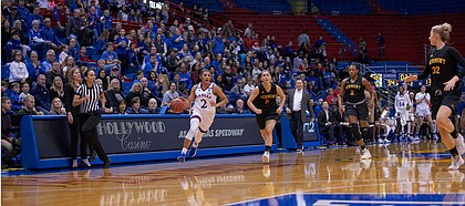 Kansas guard Brianna Osorio (2) races down the court to beat the final second in the half as Vermont's Josie Larkins (5) and Carmen Handy (32) try to guard her on Sunday, Dec. 30, 2018 at Allen Fieldhouse.