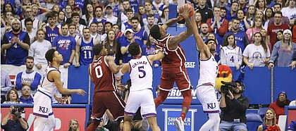 Kansas forward Dedric Lawson (1) gets a hand on a late shot from Oklahoma forward Kristian Doolittle (21) with seconds remaining in the game, Wednesday, Jan. 2, 2019 at Allen Fieldhouse.