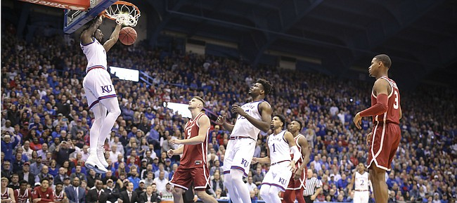Kansas guard Marcus Garrett (0) comes down with a dunk against Oklahoma during the first half, Wednesday, Jan. 2, 2019 at Allen Fieldhouse.