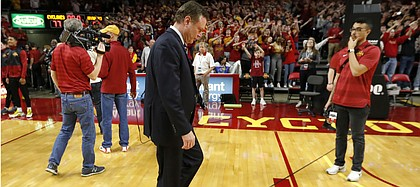 Kansas head coach Bill Self, center, walks off the court after an NCAA college basketball game against Iowa State, Saturday, Jan. 5, 2019, in Ames, Iowa.