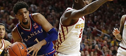 Kansas forward Dedric Lawson, left, drives around Iowa State forward Cameron Lard during the second half of an NCAA college basketball game, Saturday, Jan. 5, 2019, in Ames, Iowa.