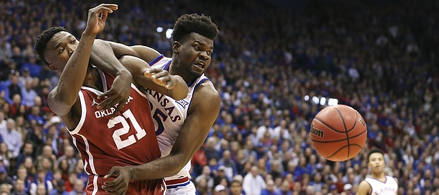 Kansas center Udoka Azubuike (35) and Oklahoma forward Kristian Doolittle (21) wrestle for position on a loose ball during the first half, Wednesday, Jan. 2, 2019 at Allen Fieldhouse.