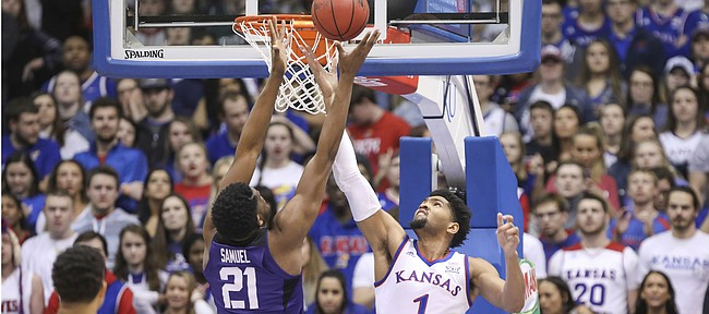 Kansas forward Dedric Lawson (1) battles for a rebound with TCU center Kevin Samuel (21) during the first half, Wednesday, Jan. 9, 2019 at Allen Fieldhouse.