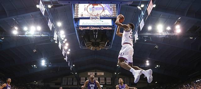Kansas guard Ochai Agbaji (30) gets up for a lob dunk during the first half, Wednesday, Jan. 9, 2019 at Allen Fieldhouse.