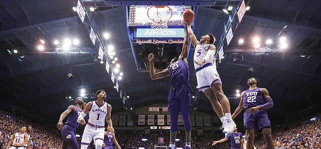 Kansas guard Quentin Grimes (5) gets to the bucket against TCU center Kevin Samuel (21) during the first half, Wednesday, Jan. 9, 2019 at Allen Fieldhouse.