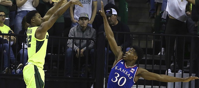 Baylor guard Jared Butler (12) shoots over Kansas guard Ochai Agbaji (30) in the first half of an NCAA college basketball game, Saturday, Jan. 12, 2019, in Waco, Texas.
