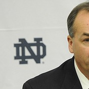 FILE — Former Notre Dame offensive coordinator Mike Denbrock answers questions at a press conference Friday Jan. 31, 2013 in South Bend, Ind. Denbrock is currently the offensive coordinator and tight ends coach at Cincinnati. (AP Photo/Joe Raymond)