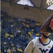 Kansas guard Marcus Garrett (0) grabs a rebound against West Virginia forward Derek Culver (1) during the first half of an NCAA college basketball game Saturday, Jan. 19, 2019, in Morgantown, W.Va. (AP Photo/Raymond Thompson)