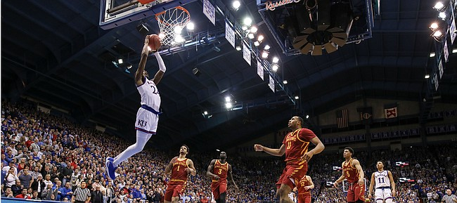 Kansas guard Lagerald Vick (24) gets up for a lob jam to get the Jayhawks fired up during the second half, Monday, Jan. 21, 2019 at Allen Fieldhouse.