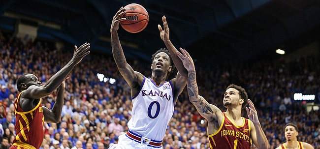 Kansas guard Marcus Garrett (0) gets in for a bucket between Iowa State guard Marial Shayok (3) and Iowa State guard Nick Weiler-Babb (1) during the second half, Monday, Jan. 21, 2019 at Allen Fieldhouse.