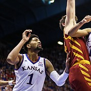 Kansas guard Devon Dotson (11) swoops in to the bucket against Iowa State forward Michael Jacobson (12) during the second half, Monday, Jan. 21, 2019 at Allen Fieldhouse.
