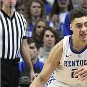 Kentucky's Reid Travis (22) drives on Kansas' Dedric Lawson during the second half of an NCAA college basketball game in Lexington, Ky., Saturday, Jan. 26, 2019. Kentucky won 71-63. (AP Photo/James Crisp)