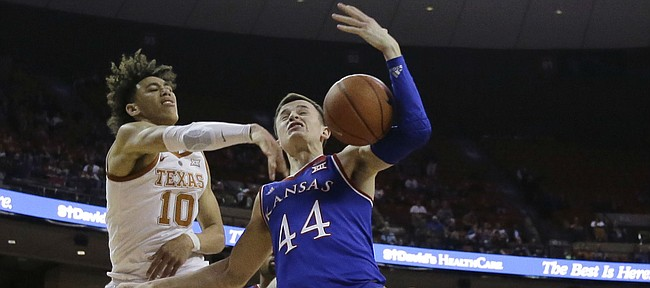Texas forward Jaxson Hayes (10) blocks Kansas forward Mitch Lightfoot (44) as he tries to score during the first half on an NCAA college basketball game in Austin, Texas, Tuesday, Jan. 29, 2019. (AP Photo/Eric Gay)