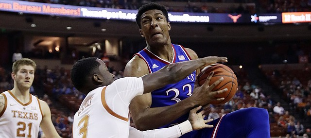Kansas forward David McCormack (33) is pressured by Texas guard Courtney Ramey (3) during the first half on an NCAA college basketball game in Austin, Texas, Tuesday, Jan. 29, 2019. (AP Photo/Eric Gay)