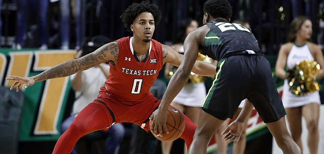 Texas Tech 's Kyler Edwards (0) defends as Baylor's Jared Butler handles the ball during an NCAA college basketball game, Saturday, Jan. 19, 2019, in Waco, Texas.
