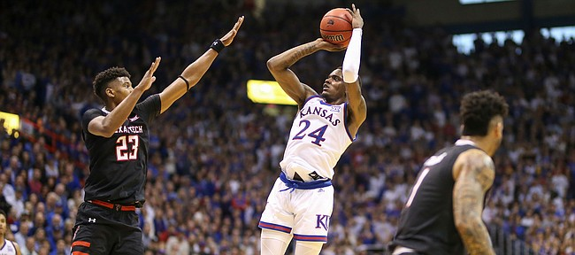 Kansas guard Lagerald Vick (24) fades back for a shot over Texas Tech guard Jarrett Culver (23) during the first half, Saturday, Feb. 2, 2019 at Allen Fieldhouse.