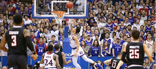 Kansas guard Devon Dotson (11) puts in a layup after a steal during the second half, Saturday, Feb. 2, 2019 at Allen Fieldhouse.