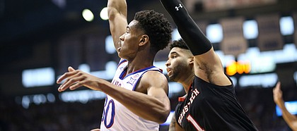 Kansas guard Ochai Agbaji (30) hangs his hand after putting up a three during the first half, Saturday, Feb. 2, 2019 at Allen Fieldhouse.