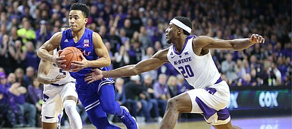 Kansas guard Devon Dotson (11) moves to the bucket past Kansas State forward Xavier Sneed (20) during the first half, Tuesday, Feb. 5, 2019 at Bramlage Coliseum.