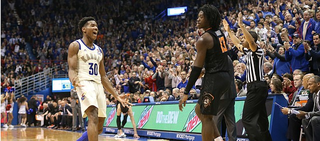 Kansas guard Ochai Agbaji (30) celebrates a three pointer over Oklahoma State guard Isaac Likekele (13) during the second half, Saturday, Feb. 9, 2019 at Allen Fieldhouse.