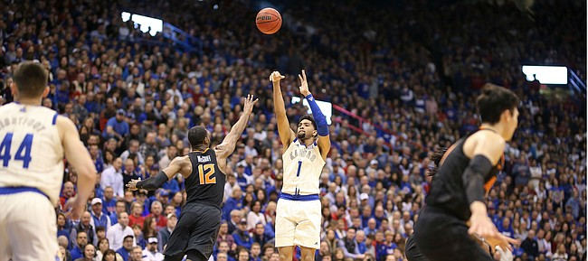 Kansas forward Dedric Lawson (1) puts up a three over Oklahoma State forward Cameron McGriff (12) during the first half, Saturday, Feb. 9, 2019 at Allen Fieldhouse.