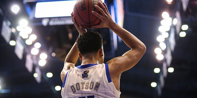 Kansas guard Devon Dotson (11) inbounds the ball during the second half, Saturday, Feb. 9, 2019 at Allen Fieldhouse.