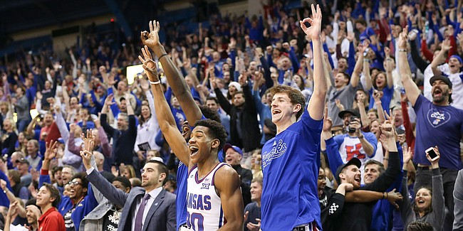 Kansas guard Ochai Agbaji (30) and Kansas guard Garrett Luinstra (20) erupt after a three by Kansas guard Chris Teahan (12) late in the second half, Saturday, Feb. 16, 2019 at Allen Fieldhouse.