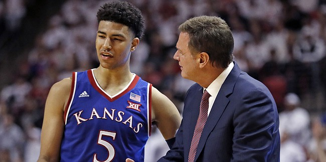 Kansas coach Bill Self talks to Quentin Grimes during the second half of the team's NCAA college basketball game against Texas Tech, Saturday, Feb. 23, 2019, in Lubbock, Texas. (AP Photo/Brad Tollefson)
