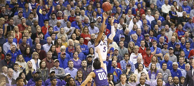 Kansas guard Quentin Grimes (5) puts up a three from the corner over Kansas State guard Mike McGuirl (0) during the first half, Monday, Feb. 25, 2019 at Allen Fieldhouse.