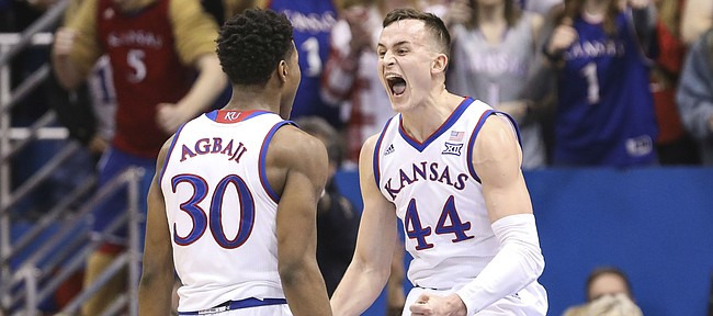 Kansas forward Mitch Lightfoot (44) celebrates with Kansas guard Ochai Agbaji (30) after drawing a charge against Kansas State during the first half, Monday, Feb. 25, 2019 at Allen Fieldhouse.