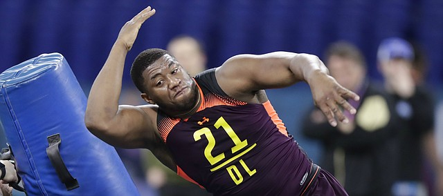 Kansas defensive lineman Daniel Wise runs a drill at the NFL football scouting combine in Indianapolis, Sunday, March 3, 2019. (AP Photo/Michael Conroy)
