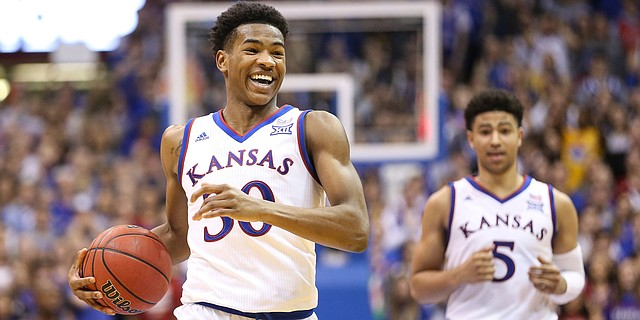 Kansas guard Ochai Agbaji (30) smiles after a near breakaway for a dunk during the second half, Monday, Feb. 25, 2019 at Allen Fieldhouse.