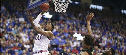 Kansas forward David McCormack (33) puts in a bucket during the first half, Saturday, March 9, 2019 at Allen Fieldhouse.