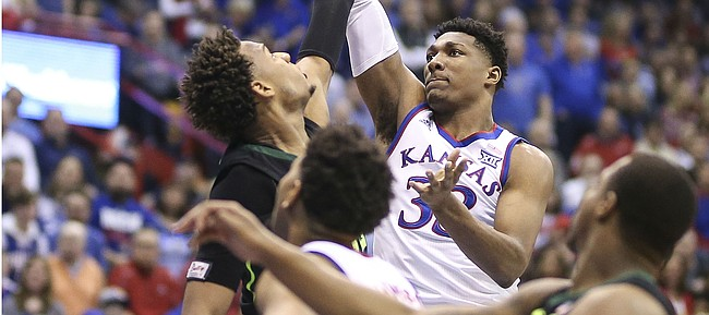 Kansas forward David McCormack (33) puts a shot over Baylor forward Freddie Gillespie (33) during the first half, Saturday, March 9, 2019 at Allen Fieldhouse.