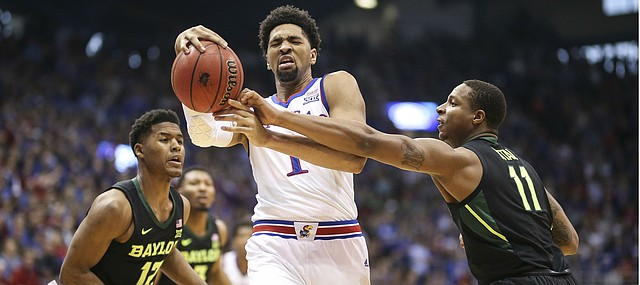 Kansas forward Dedric Lawson (1) is hounded by Baylor guard Mark Vital (11) and Baylor guard Jared Butler (12) during the first half, Saturday, March 9, 2019 at Allen Fieldhouse.