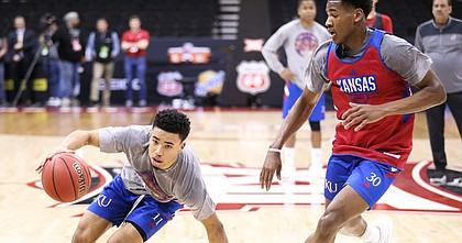 Kansas guard Devon Dotson (11) regains control of the ball as he drives against Kansas guard Ochai Agbaji (30) during an open practice on Wednesday, March 13, 2019 at Sprint Center.