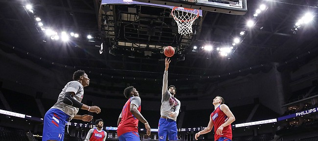 Kansas forward Dedric Lawson puts up a shot in the paint during an open practice on Wednesday, March 13, 2019 at Sprint Center.